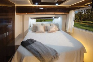 Sunliner Monte Carlo MC3 - Bedroom with two slide out walls to create luxurious space.